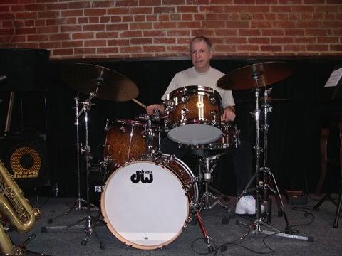 Henry playing dw drums jazz kit