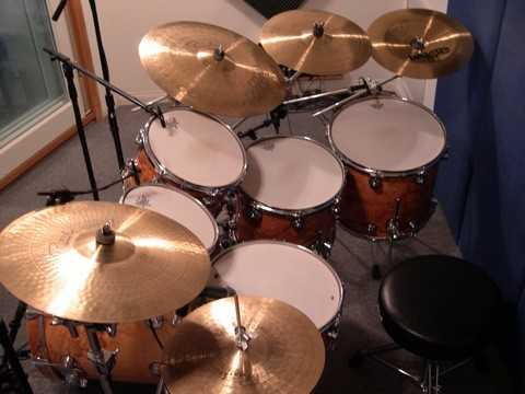 studio drum kit showing all drums and cymbals and seat